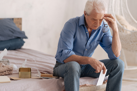 gerontology: Thoughtful depressed man being involved in his memories