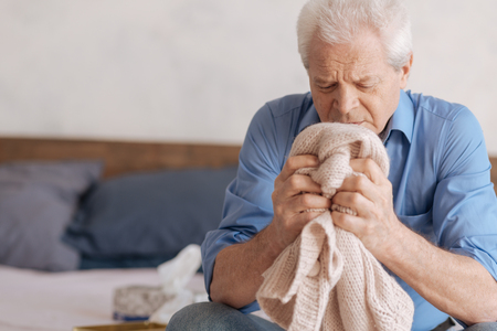 Cheerless aged man grieving about his wife