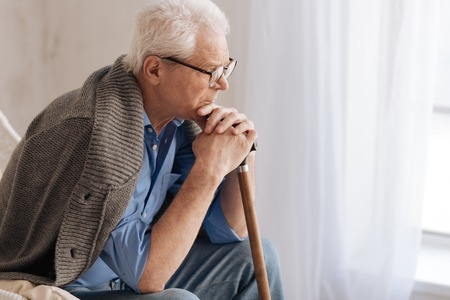 gerontology: Gloomy unhappy man thinking about life