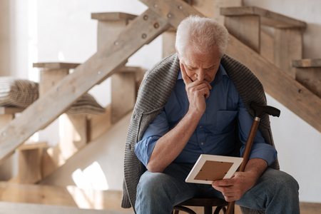 gerontology: Thoughtful nice man missing his wife Stock Photo