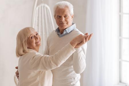 gerontology: Joyful happy couple dancing together