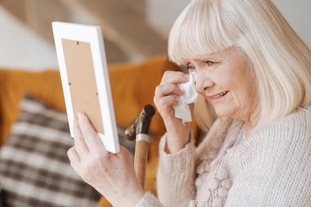 gerontology: Miserable depressed woman crying Stock Photo
