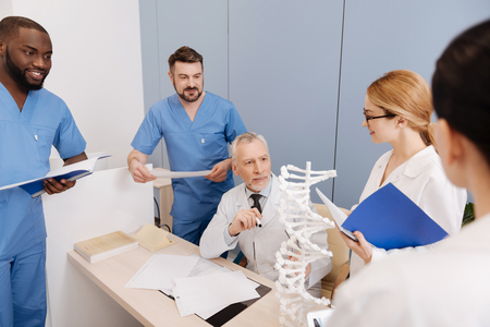 Aging mentor conducting exam in the medical university Stock Photo