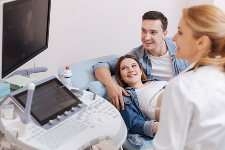 Young family enjoying appointment at the sonography cabinet