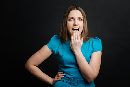 gerontology: Amused young woman reacting on news in the studio