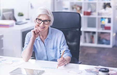 Friendly female sitting at her workplace Stock Photo