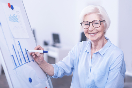 social work aged care: Amazing woman posing near board