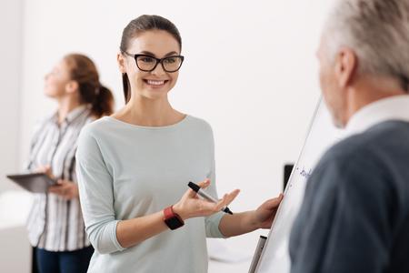 Beautiful secretary presenting her excellent work Stock Photo