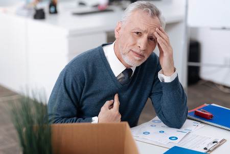 dismissed: Upset office worker wrinkling his forehead