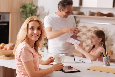 Delightful woman enjoying family holiday at home