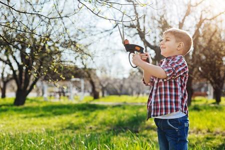 Cheerful kid playing in garden Stock Photo