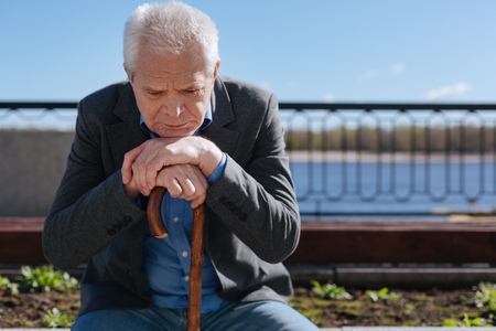 Aged man thinking about his life outdoors