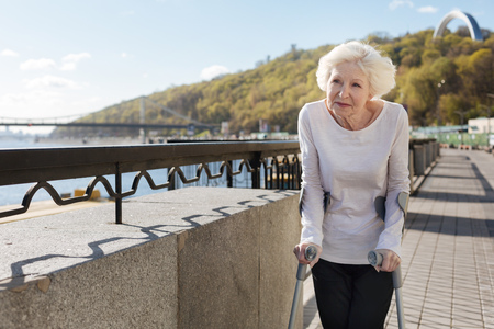 Happy pensioner looking into distance Stock Photo