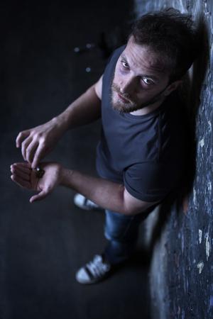 junky: Mad drug user holding marijuana cigarette outdoors