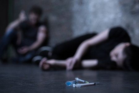 junky: Empty syringes lying on the ground Stock Photo