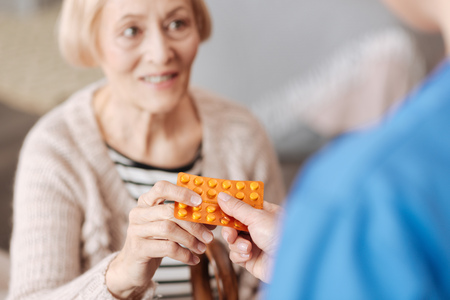 Cute optimistic woman receiving some vitamins
