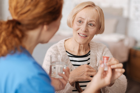 Lovely elderly woman receiving medical assistance Stock Photo