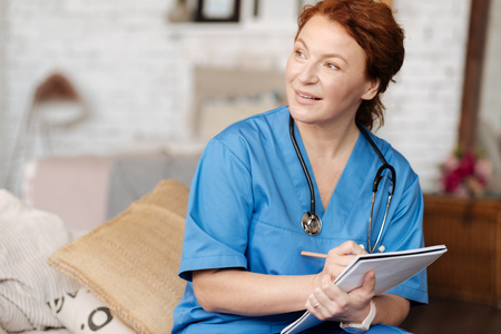 Wonderful experienced doctor asking her patient about his concerns