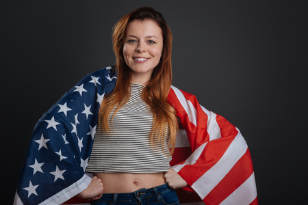 patriot act: Optimistic bright girl posing with a flag Stock Photo