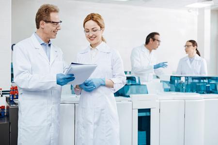 genomics: Attractive female worker listening to her colleague Stock Photo