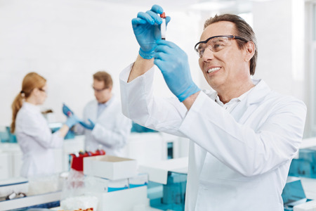 Positive delighted scientist standing in semi position
