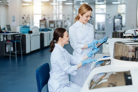 genomics: Positive delighted women working in the laboratory