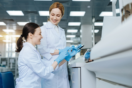 genomics: Delighted female lab assistants expressing positivity