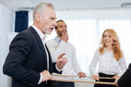 teambuilding: Pleasant elderly man speaking