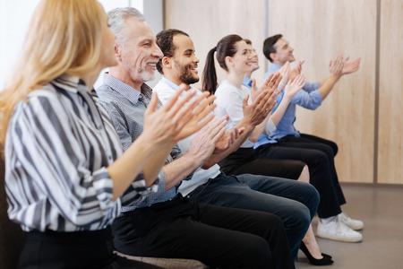 applauding: Happy joyful people applauding Stock Photo