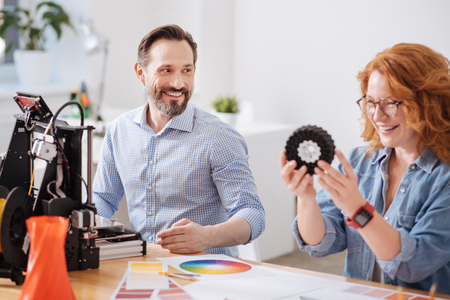 Happy positive man looking at his colleague Stock Photo