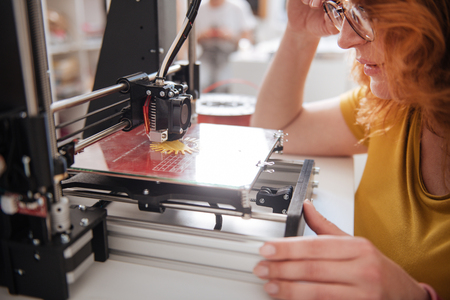 Close up of a 3d printer being in work Stock Photo