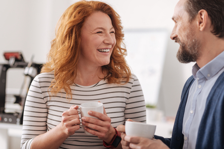 Delighted positive woman laughing Stock Photo
