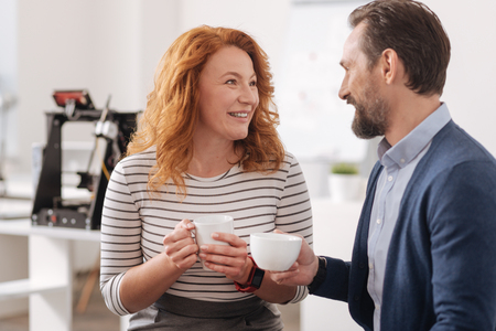 Happy delighted colleagues having coffee Stock Photo