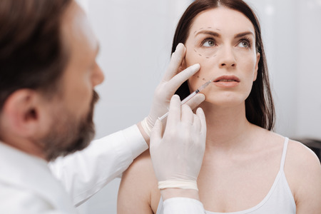 marking up: True beauty professional injecting botox