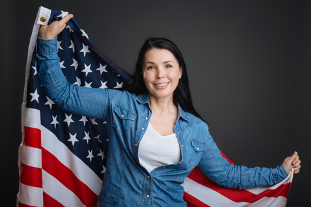 patriot act: Proud loyal lady holding up Stars and Stripes