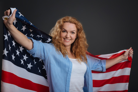 patriot act: Admirable positive woman being a patriotic citizen Stock Photo