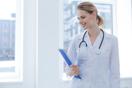 Lively practitioner enjoying work at the clinic Stock Photo