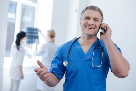 technologist: Delighted radiologic technologist enjoying conversation at work