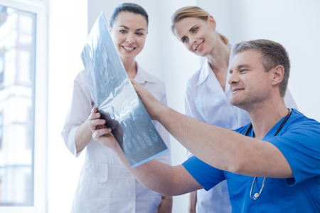 Upbeat radiologists examining ct scan in the medical lab Stock Photo