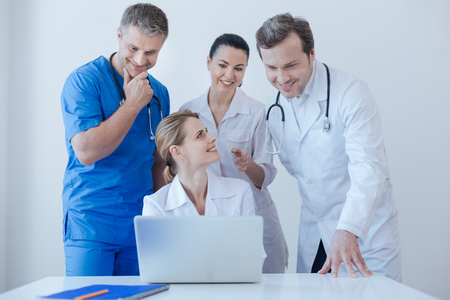 Helpful practitioners using laptop for work at the hospital