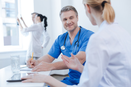 Energetic doctors enjoying discussion at the hospital