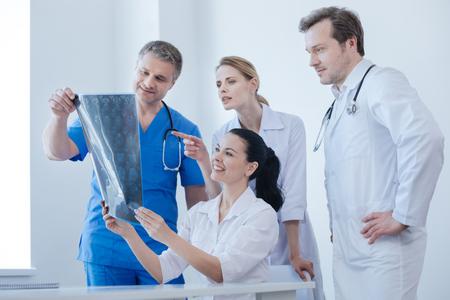Communicative therapists examining x ray photo in the examination room Stock Photo
