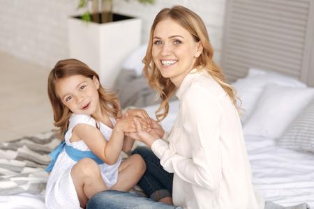 Lovely single-parent family bonding on the bed