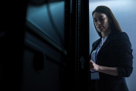 Serious pleasant woman locking the door