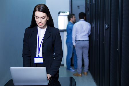 Serious attractive woman working on the laptop