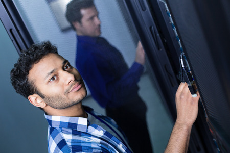 Pleasant delighted man working with informational technologies