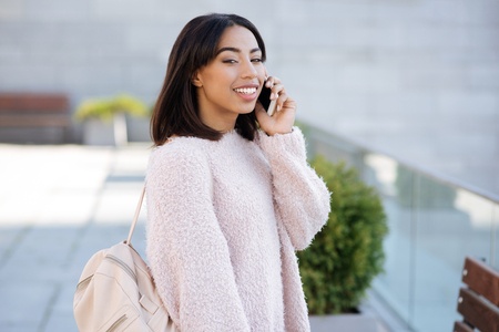 Engaging genuine woman talking to her friend on the phone