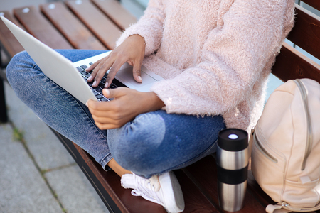 productive: Motivated clever woman enjoying studying outside Stock Photo