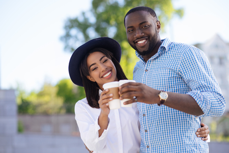 out of date: Modern active couple drinking coffee