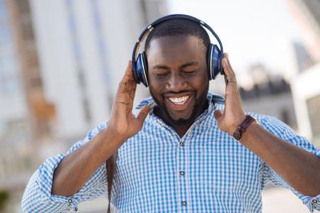 Attractive inspired man enjoying perfect sound Stock Photo